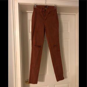 FashionNova Rust color jeans. Size 7 (W27)